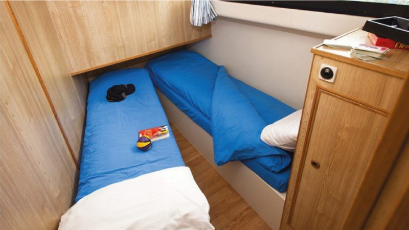 Elegance - Portside Central Cabin choice of 1 Double Bed or 2 Single Beds