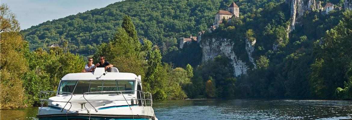 The village of St Cirq on the Lot discover barge without license on canal boating holidays