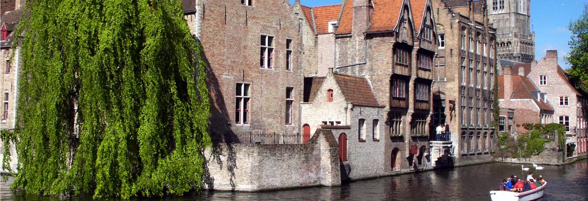 The city of Brugge in Belgium in rental boat without license